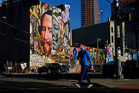 A man walks near a graffiti during a sunny day in the Neighborhood of Jersey City in New Jersey, 12/15/2015 Photo by VIEWpress