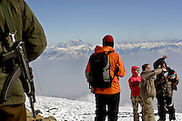 Skiers and an Indian soldier protecting the ski resort of Gulmarg in Kashmir.  Gulmarg is famed for its gondola (3980m), the gondola which opened in 2005 is the worlds highest and has been drawing snowboarders and skiers from around the world. Gulmarg is only 10km from the line of control that seperates Pakistan Kashmir from Indian Kashmir which means its situated in a conflict zone. But improved relations between the two countries as well as a peace process within Kashmir have meant more skiers are now flocking to the area for what is said to be some of the best skiing in the world.