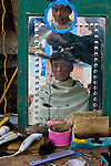 Haircutting at market, Yuanyang, China