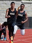 NAUGATUCK,  CT-051617JS08- WCA's Zehki DeSouza, left, takes the hand off from teammate Josiah Rivers in the 4x100m relay during their meet with Naugatuck and Seymour Tuesday at Naugatuck High School. <br />  Jim Shannon Republican-American