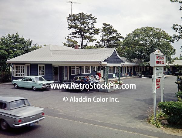 Americana Motel, Bass River, MA. Motel exterior with sing and old cars.