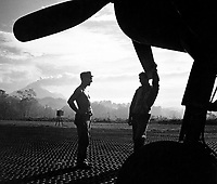 VF-17 ground crewmen await word to ready F4U for takeoff on Rabaul raid from Piva strip on Bougainville.  February 1944.  Lt. Comdr. Charles Fenno Jacobs.  (Navy)<br /> Exact Date Shot Unknown<br /> NARA FILE #:  080-G-475071<br /> WAR &amp; CONFLICT BOOK #:  967