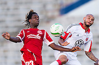 Joseph Ngwenya (27) of the Richmond Kickers goes up for a header with Perry Kitchen (23) of D.C. United during a third round match in the US Open Cup at City Stadium in Richmond, VA.  D.C. United advanced on penalty kicks after tying the Richmond Kickers, 0-0.