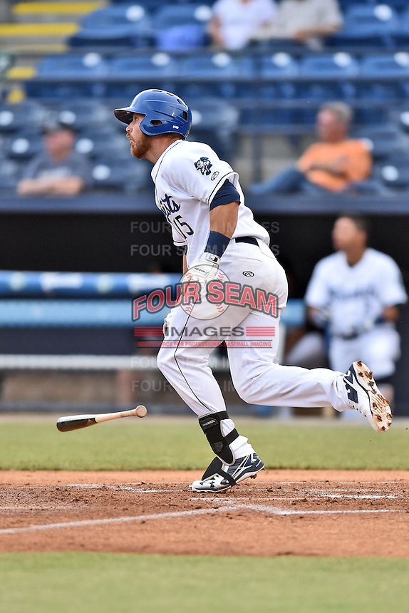 Asheville Tourists first baseman Brian Mundell (15) swings at a pitch during a game against the Hagerstown Suns at McCormick Field on April 27, 2016 in Asheville, North Carolina. The Tourists defeated the Suns 14-7. (Tony Farlow/Four Seam Images)