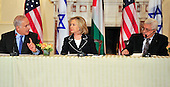 "Prime Minister Benjamin Netanyahu of Israel, left, addresses remarks to President Mahmoud Abbas of the Palestinian Authority, right, as United States Secretary of State Hillary Rodham Clinton, center, listens at the ""Relaunch of Direct Negotiations Between the Israelis and Palestinians"" in the Benjamin Franklin Room of the U.S. Department of State on Thursday, September 2, 2010.  .Credit: Ron Sachs / CNP.(RESTRICTION: NO New York or New Jersey Newspapers or newspapers within a 75 mile radius of New York City)"