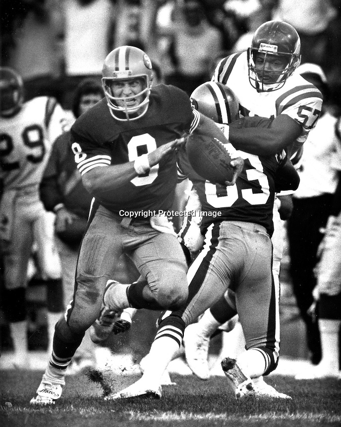 San Francisco 49er quarterback Steve Yound scrambles for a touch down against the Minnesota Vikings. (1988 photo by Ron Riesterer)
