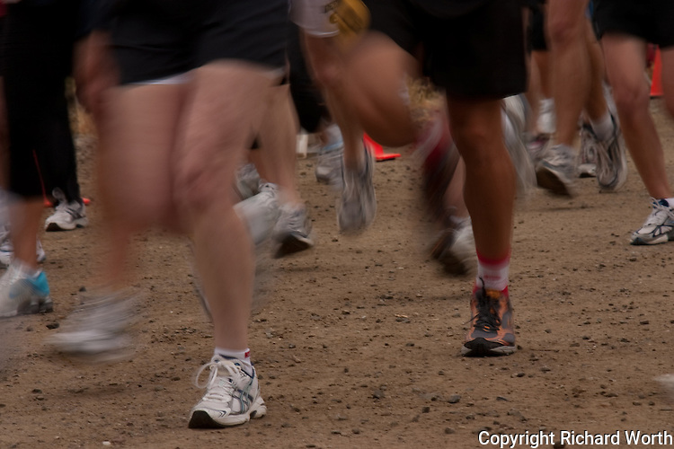 The crowded blur of legs and running shoes marks the start of a marathon held to support the local fire service.  Available for editorial use only - no model release.