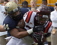Pitt linebacker Shane Gordan (44) tackles Virginia Tech running back Michael Holmes. The Pitt Panthers defeated the Virginia Tech Hokies 35-17 at Heinz field in Pittsburgh, PA on September 15, 2012.