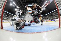 Chicago Wolves' Michael Davies is shut down by San Antonio Rampage goaltender Dov Grumet-Morris during the third period of an AHL hockey game, Friday, Oct. 4, 2013, in San Antonio. Chicago won 2-1. (Darren Abate/M3D14.com)