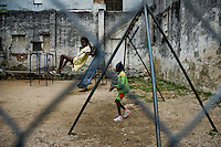 Young Cuban girls play swing on a playground in Havana, Cuba, 7 February 2009. About 50 years after the national rebellion, led by Fidel Castro, and adopting the communist ideology shortly after the victory, the Caribbean island of Cuba is the only country in Americas having the communist political system. Although the Cuban state-controlled economy has never been developed enough to allow Cubans living in social conditions similar to the US or to Europe, mostly middle-age and older Cubans still support the Castro Brothers' regime and the idea of the Cuban Revolution. Since the 1990s Cuba struggles with chronic economic crisis and mainly young Cubans call for the economic changes.