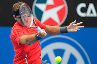 Juan Martin del Potro of Argentina hits a forehand to Nicolas Mahut of France during their men's singles match at the Sydney International tennis tournament in Sydney, Australia, Wednesday, Jan. 8, 2014.  IMAGE RESTRICTED TO EDITORIAL USE ONLY. Photo by Daniel Munoz/VIEWpress