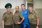 St Johnstone v FC Minsk...01.08.13 Europa League Qualifier at Neman Stadium, Grodno, Belarus...<br /> Liam Caddis pictured with Immigration staff at Grodno Airport after their 1-0 victory over FC Minsk, before boarding the flight back to Edinburgh.<br /> Picture by Graeme Hart.<br /> Copyright Perthshire Picture Agency<br /> Tel: 01738 623350  Mobile: 07990 594431