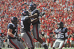 Ole Miss running back Brandon Bolden (34) and Ole Miss offensive lineman Bobby Massie (79) celebrate a touchdown vs. Kentucky at Vaught-Hemingway Stadium in Oxford, Miss. on Saturday, October 2, 2010. Ole Miss won 42-35.