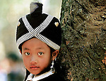 A Hmong girl wearing traditional headdress during the Hmong New Year celebrations at Luang Prabang, Laos.