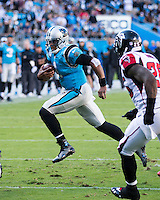 The Carolina Panthers defeated the Atlanta Falcons 34-10 in an inter-division rivalry played in Charlotte, NC at Bank of America Stadium.  Carolina Panthers quarterback Cam Newton (1) runs with the ball.