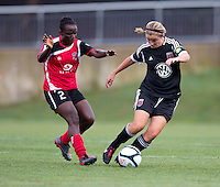 Hayley Siegel (12) of the D.C. United Women sprints away from Odishika Chukwuji (2) of the Virginia Beach Piranhas during the game at the Maryland SoccerPlex in Boyds, Maryland.  The D.C. United Women defeated the Virginia Beach Piranhas, 3-0, to advance to the W-League Eastern Conference Championship.