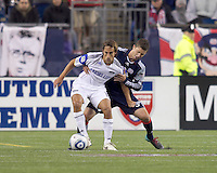 Kansas City Wizards midfielder Josh Wolff (16) dribbles while New England Revolution defender Chris Tierney (8) defends. The New England Revolution defeated Kansas City Wizards, 1-0, at Gillette Stadium on October 16, 2010.