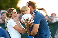 Dustin Johnson celebrates his first major win with his son, Tatum, and wife Paulina Gretzky during the 2016 U.S. Open in Oakmont, Pennsylvania on Sunday June 19, 2016. (Photo by Jared Wickerham / DKPS)