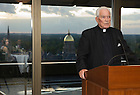 September 29, 2011; Rev. Theodore M. Hesburgh, C.S.C., says a prayer before dinner with Dr. Horst Koehler, former President of the Federal Republic of Germany, and and faculty members and guests in the 14th floor penthouse of the Hesburgh Library. Photo by Barbara Johnston/University of Notre Dame