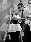 November 21, 1968, Modesto, California--Radio Man-- Dick Boynton reads Teletype.  Wellesley Richard &quot;Dick&quot; Boynton was the news editor at KBEE AM, The Modesto Bee's sister radio station.  In November 1968, Dick volunteered to be my subject for a day-in-the-life-of-a-radio-reporter story.  My goal was to improve my story-telling skills.  I asked Dick to just do his job and ignore me.  We met at 6 a.m. at the Stanislaus County jail to get booking information then were off to Modesto Police Department to read the police logs.  At MPD, we discovered a big story was unfolding.  Stanislaus County Superintendent of Schools Fred Beyer and his deputy Joseph Howard had died the night before in a plane crash coming back from Fresno.  Making images was easy under these circumstances: I just followed Dick as he worked.  I moved in and out while Dick ignored me, just as I had asked.  When he finally sat down to write copy, he talked aloud and banged away on his typewriter.  Next thing I knew, he was on the air broadcasting the news.<br /> Boynton worked as the news editor for KBEE for nearly a decade under managers Roy Swanson and Ed Boyle.  Earlier in his career, his deep, resonant voice was heard on the airwaves at KWG in Stockton.  Boynton had also worked as a newsman for radio stations in Salinas and San Diego.  Among racing fans, Dick was known as a winning driver of dragsters and super-stock cars.<br /> In September 1986, Dick Boynton ended his own life. Some said he was despondent over being laid off from KBEE.  Photo by AL Golub/Golub Photography