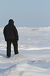 A man walks on the frozen Great Slave Lake in Northwest Territories.