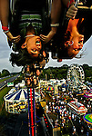 West Friendship, Md.--8/11/04-- .Laura Gaeng, left, 14, and Jen Hopkins, 14, both of Columbia, Md., enjoy an inverted view of the Howard County Fair by way of the &quot;Fire Ball&quot; roller coaster.<br />