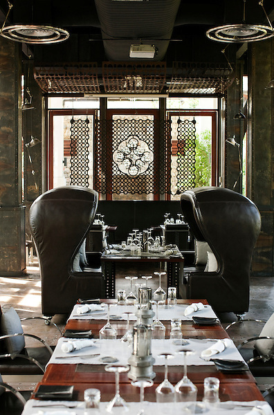 Rivet Grille, Indigo Pearl Resort, Phuket, Thailand. The Rivet Grille is one of three main restaurants at Indigo Pearl, Phuket. Specializing in grilled cuisine and designed by Bensley Design Studios, the tin mine factory theme is evident in the details throughout the space.