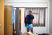 A member of the Indian Kabbadi team gets ready in his room for a morning training session at a month long camp in Sport Authority of India Sports Complex in Bisankhedi, outskirts of Bhopal, Madhya Pradesh, India.