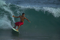 Salvador, Brazil, October 2004. Surfing the waves of the Atlantic Ocean.  The streets of Salvadors historical center are lined with colorful buildings from colonial times.  Photo by Frits Meyst/Adventure4ever.com