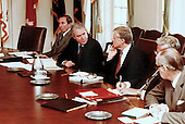 United States President Jimmy Carter returned from Camp David, the Presidential retreat near Thurmont, Maryland, to meet with his National Security Council concerning the crisis in Iran and the Soviet invasion of Afghanistan in the Cabinet Room of the White House in Washington, DC on January 2, 1980.  Pictured with the President are Deputy US Secretary of State Warren Christopher, left, US Secretary of State Cyrus Vance, center.  In response to the crisis only United Nations sanctions have been proposed but members of the Carter Administration are considering other measures to gain the release of the American hostages in Iran and sanctions against the Soviets for invading Afghanistan.<br /> Mandatory Credit: Bill Fitz-Patrick / White House via CNP
