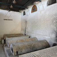 Tombs in the Jewish cemetery in the South West corner of the Mellah or Jewish quarter, established in 1438 when the Jews were driven out of the old town to al-Mallah, Fes, Fes-Boulemane, Northern Morocco. The tombs in separate enclosures are of rabbis, like these with Hebrew inscriptions and Stars of David on the enclosure walls. The oldest tombs date to the 16th century. In the 9th century, Idriss II admitted many Jews to Fes from Andalusia, the Jewish community thrived here until the 11th century. Picture by Manuel Cohen