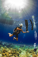 22 July 2015: SCUBA Instructor Ragime Powery plays with his neutrally buoyant fins towards the end of a dive at Ocean Pointe Reef, on the North Shore of Grand Cayman Island. Located in the British West Indies in the Caribbean, the Cayman Islands are renowned for excellent scuba diving, snorkeling, beaches and banking.  Mandatory Credit: Ed Wolfstein Photo *** RAW (NEF) Image File Available ***