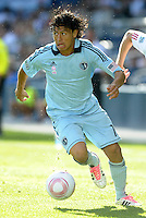 Sporting KC midfielder Roger Espinoza (15) in action... Sporting Kansas City defeated New York Red Bulls 2-1 at LIVESTRONG Sporting Park, Kansas City, Kansas.