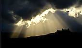 Rays of light breaking through the clouds during sunset, Southland, New Zealand