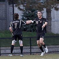 Brown University forward Ben Maurey (13) celebrates winning goal with teammate. Brown University (black) defeated Boston College (white), 1-0, at Newton Campus Field, October 16, 2012.