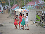 Four girls walk along the main street in Bacubac, a seaside neighborhood in Basey in the Philippines province of Samar that was hit hard by Typhoon Haiyan in November 2013. The storm was known locally as Yolanda. The ACT Alliance has been providing a variety of assistance to survivors here.