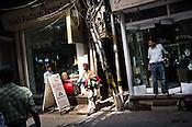 Pedestrians walk past rows of jewellery stores Dariba Kalan in Old Delhi, India. Photo: Sanjit Das/Panos Pictures