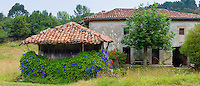 Traditional home with raised hay barn near Valle de Valdeon in Picos de Europa, Northern Spain
