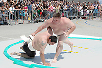 Six-time US Sumo Heavyweight Champion Dan Kalbfleisch throws Omar Coronado during the Muscle Beach Sumo Classic on Saturday, May 28, 2011. Kalbfleisch won first place in the Muscle Beach Sumo Classic.