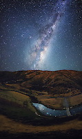 This image is one of those unexpected and unplanned shots which I happened to stumble across as I headed back to my car after a session of photographing the night sky. The Milky Way is soring high above the landscape, but reflects beautifully into the river below, giving the image a very surreal feeling.