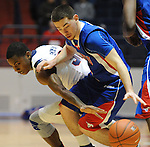 Mississippi's Jarvis Summers(32) and SMU's Jeremiah Samarrippas (12) go for the ball at the C.M. &quot;Tad&quot; Smith Coliseum in Oxford, Miss. on Tuesday, January 3, 2012. (AP Photo/Oxford Eagle, Bruce Newman)