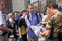 Moscow, Russia, 27/05/2007..A Russian nationalist tears a poster from the hands of veteran British gay rights activist Peter Tatchell at  Moscow's second attempted Gay Pride parade. The parade had already been banned by Moscow Mayor Yuri Luzhkov on the grounds that it would provoke violence, but gay activists attempted to demonstrate in defiance of the ban, and many were beaten by counter demonstrators and arrested by police.