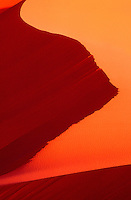 792800140 abstract dune patterns turn golden red in low angled late afternoon sunlight in coral pink sand dunes state park in utah