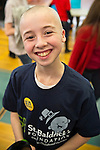 RYAN ROSENBLUM, 13, of Merrick, has just had his head shaved at St. Baldrick's fund raising event at Calhoun High School. The Long Island school exceeded its goal of raising $50,000 for childhood cancer research. Plus, many ponytails cut off will be donated to Locks of Love foundation, which collects hair donations to make wigs for children who lost their hair due to medical reasons.