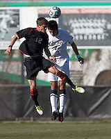 Northeastern University forward Don Anding (12) and University of Connecticut defender Michael Mercado (3) battle for head ball. .NCAA Tournament. University of Connecticut (white) defeated Northeastern University (black), 1-0, at Morrone Stadium at University of Connecticut on November 18, 2012.