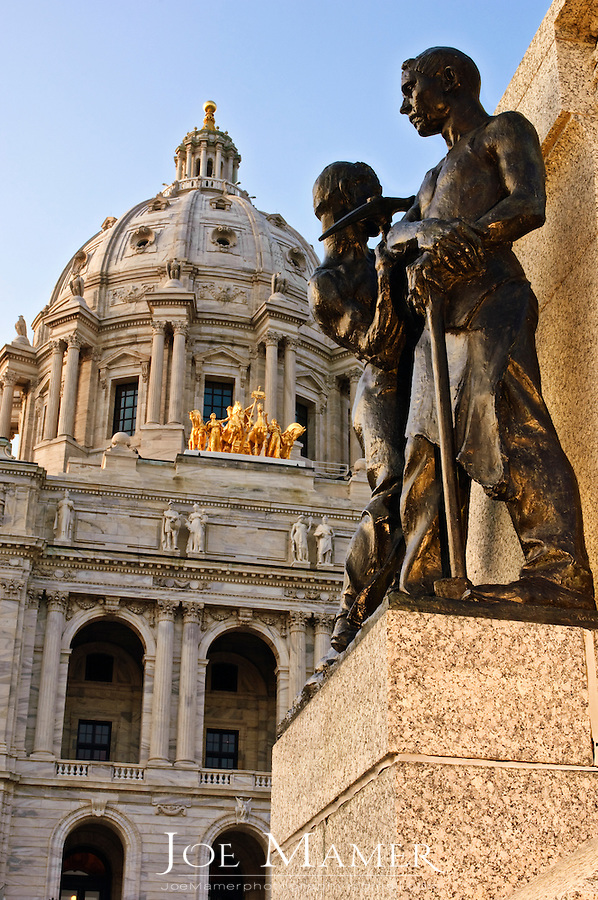 Statue in front of the Minnesota State capitol building. The building was designed by Cass Gilbert. The unsupported dome is the second largest in the world, after Saint Peter's. Work began in on the capitol in 1896, and construction was completed in 1905. It is the third building to serve this purpose: the first capitol was destroyed by fire in 1881, and the second was completed in 1883, but was considered to be too small almost immediately...