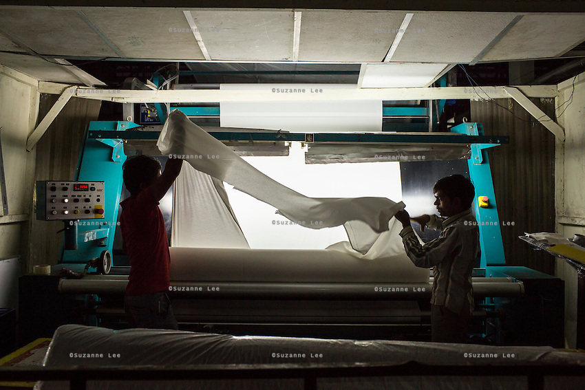 Workers working on textiles in the Pratibha vertically integrated garment unit in Indore, Madhya Pradesh, India on 11 November 2014. Photo by Suzanne Lee for Fairtrade