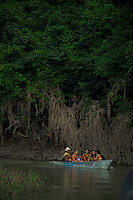 Amazone, Brazil, October 2004. The Amazone river and Rio Negro connect the small rain forest communities that dot the region. The Amazon represents over half of the planet's remaining rainforests and comprises the largest and most species-rich tract of tropical rainforest in the world. River Amazon (Portuguese: Rio Amazonas; Spanish: Río Amazonas) of South America is the largest river in the world by volume, with total river flow greater than all the other top ten largest rivers flowing into the ocean combined. The Amazon drains an area of some 6,915,000 square kilometres (2,670,000 sq mi), or some 40 percent of South America. Photo by Frits Meyst/Adventure4ever.com