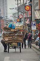 Carboard on a hand cart in Shanghai street..Shanghai, February 2006.