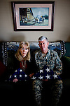 Major General Mark Graham and his wife, Carol, sit for a portrait with the flags that draped the caskets of their two dead sons, Jeff and Kevin.  Second Lt. Jeff Graham was killed by a roadside bomb in Iraq just months after their other son, ROTC Cadet Kevin Graham, committed suicide in his apartment.  Since Kevin's suicide, the Grahams have been outspoken advocates for suicide prevention.